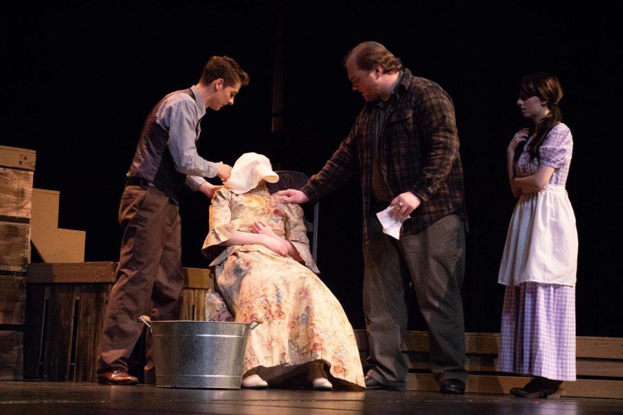 Dr. Gray (Sasha Bogatyrev) and Crutch Collins (Christopher Bottman) tending to the sick Belva Collins (Sarah Acheson).
