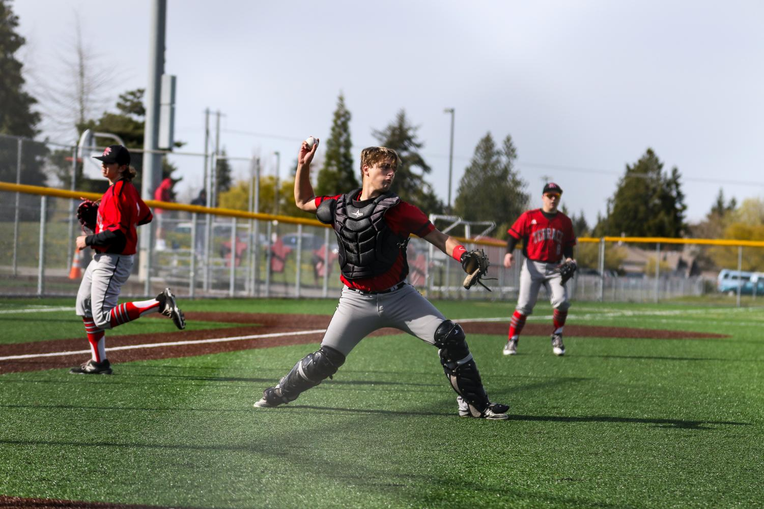 Catcher Dan Bingaman picking up and fielding the ball after the hitter bunted it