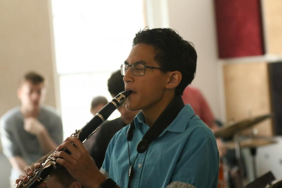 Junior Reiden Chea switches out his saxophone for his clarinet during