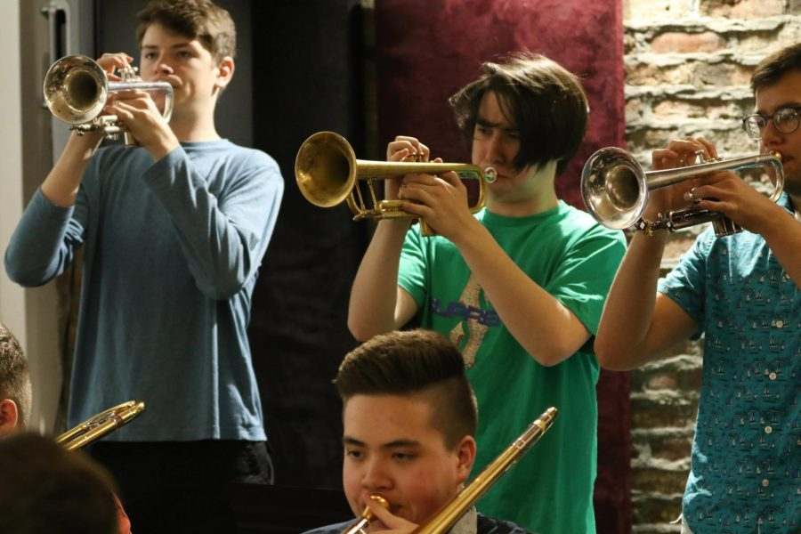 The trumpet section follows DiCioccio's advice and works on wailing their instruments.