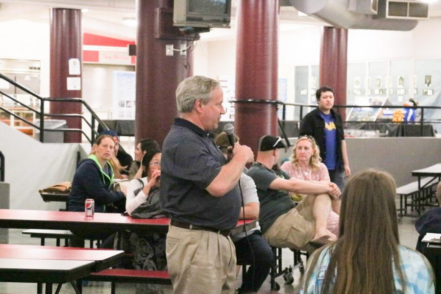 Craig Devine gives a speech at the annual STEM barbecue to commend seniors in STEM English 12 for their year-long work on their projects.