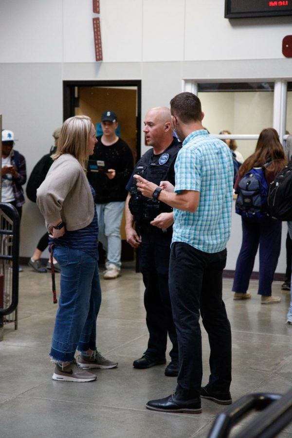 School psychologist Julie Schwab and Educational Assistant David Whalen speak with an officer from the Mountlake Terrace police department to assess the validity of the threats towards MTHS.