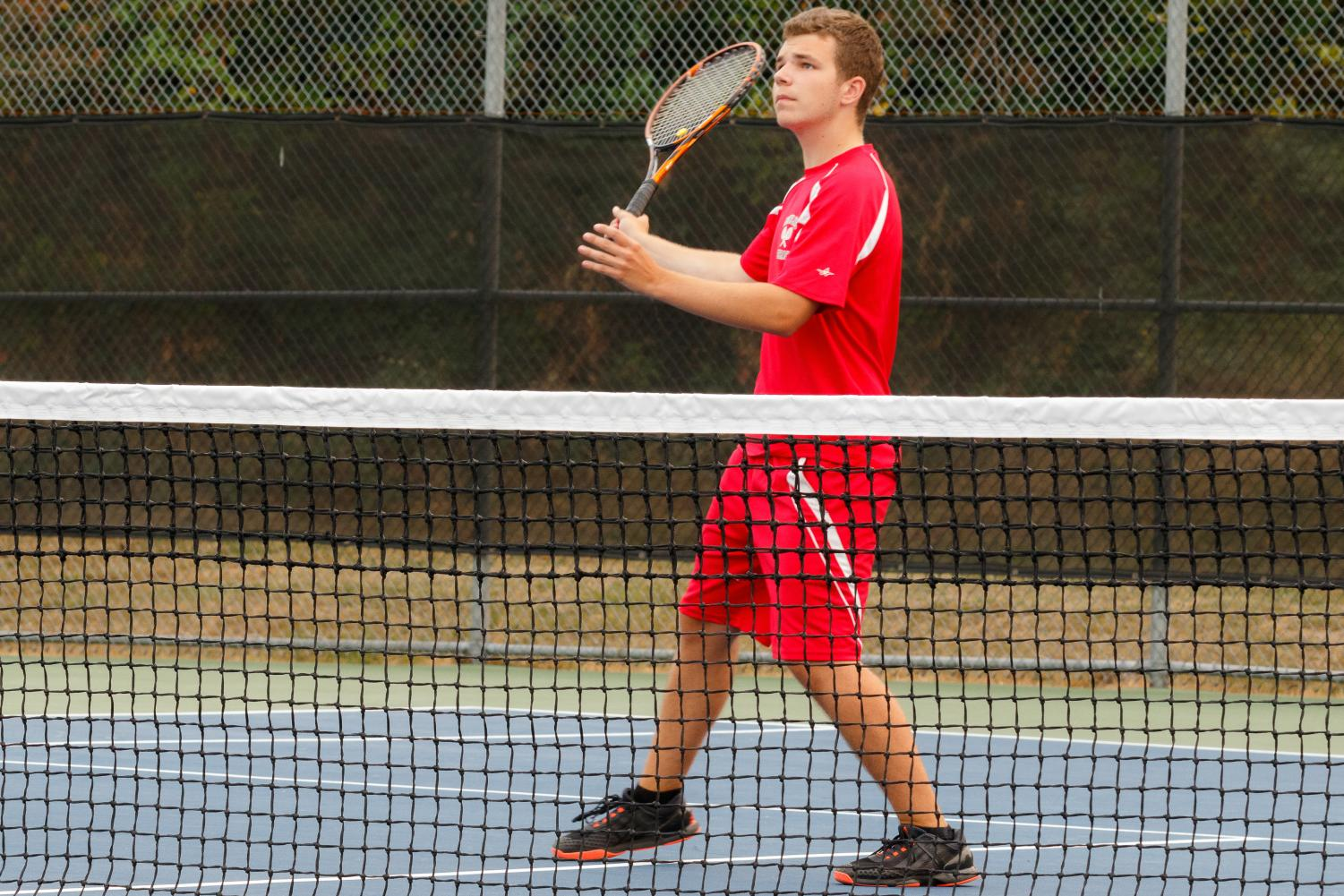 Senior Jake Peters keeps his eye on the ball at tennis practice on the MTHS tennis courts.