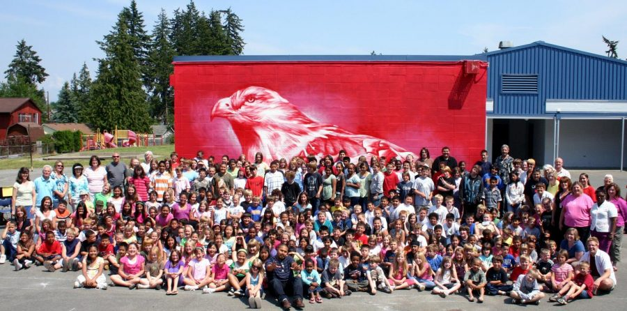 The Mountlake Terrace Elementary community poses in front of Andrew Morrison's hawk mural at the former school site. Photo courtesy of Andrew Morrison's website.