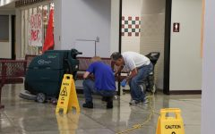 Clogged toilet causes flood in women's bathroom, Career Center
