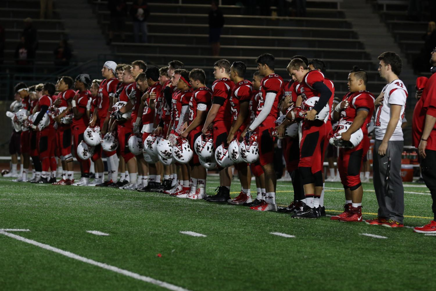 The Hawks football team focus their attention to pre-game routines before their match against the Mercer Island Islanders on Aug. 31. This season opener with a 28-6 loss for the Hawks, who are starting their first year in the 2A Northwest Conference Lake Division.