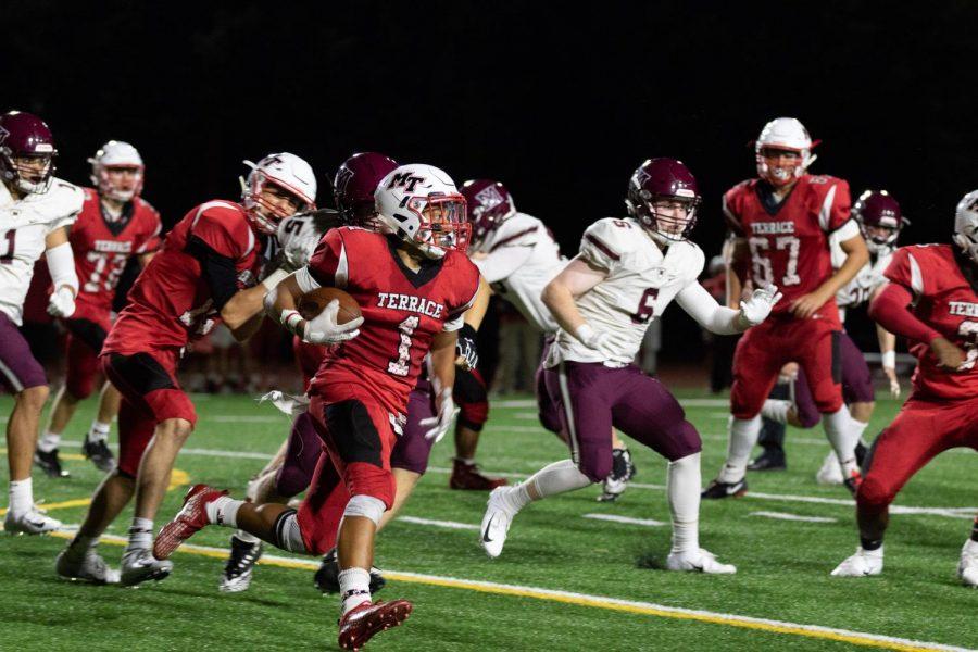 Sophomore Jordan Sims runs through the sideline.