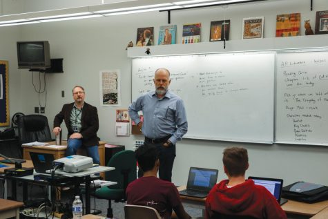 Assistant Principal Dan Falk informs Robert Reichle's third period English 9 class of impending schedule changes. Reichle also had his first period AP Literature class affected as one of the six cut in the face of lower-than-expected attendance numbers.