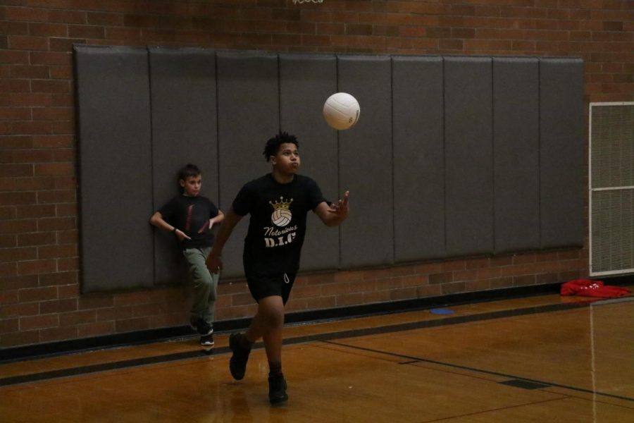 Junior Seydou Traore of Notorious D.I.G. prepares to serve the ball to Jeepers Creepers Here Come the Teachers.