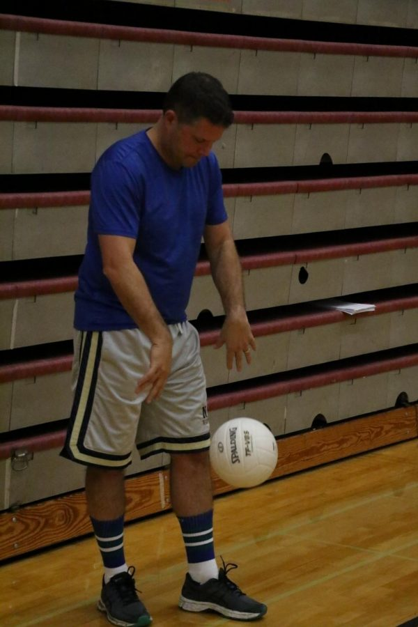 Sophomore humanities teacher Christopher Ellinger psyches himself up during a game.