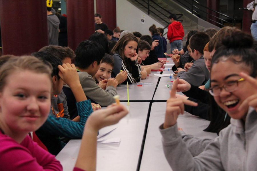 Eighth graders considering the MTHS STEM program pose during a rocket-building activity.