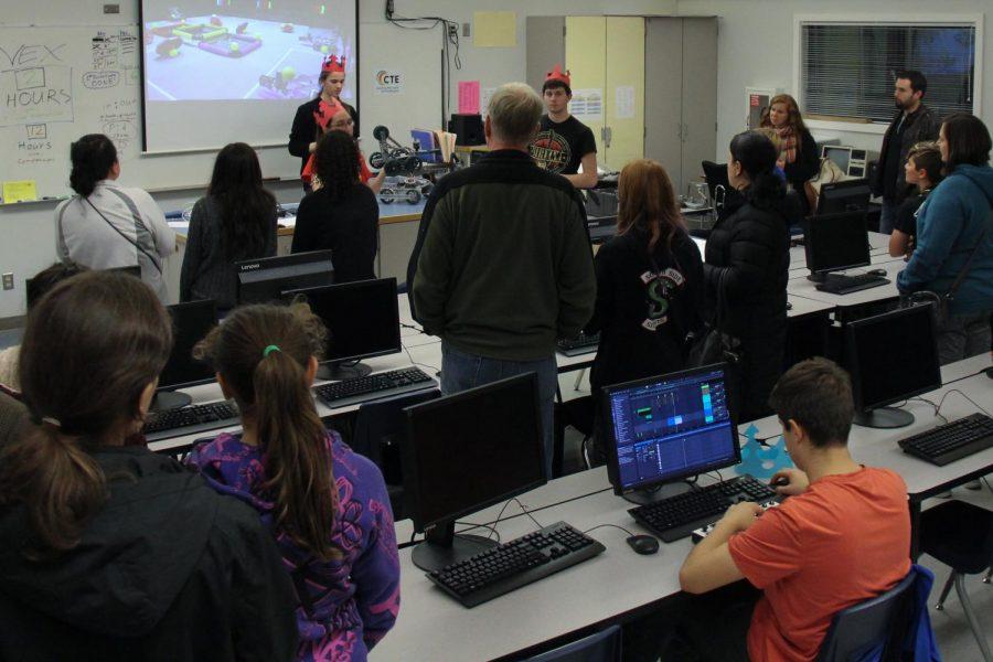 Parents of prospective STEM freshmen watch a presentation by members of MTHS robotics.