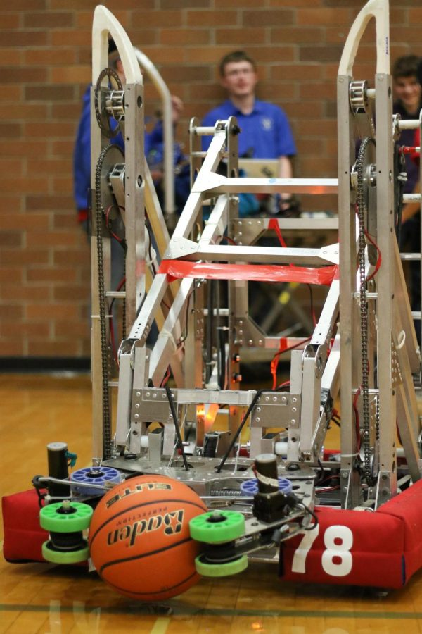The MTHS Robotics team, Chill Out, steers their robot so it can dunk the ball.