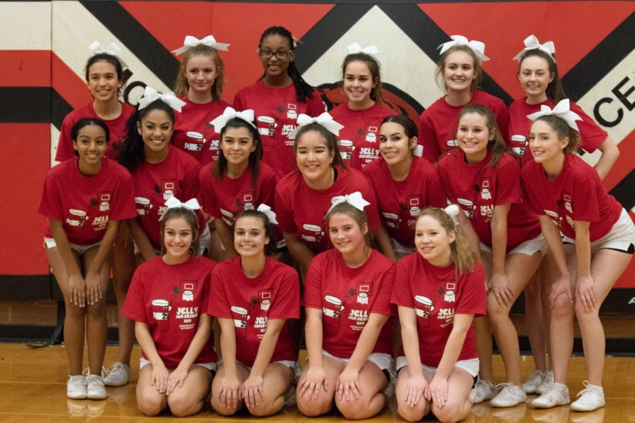 Cheerleaders pose after their routine.