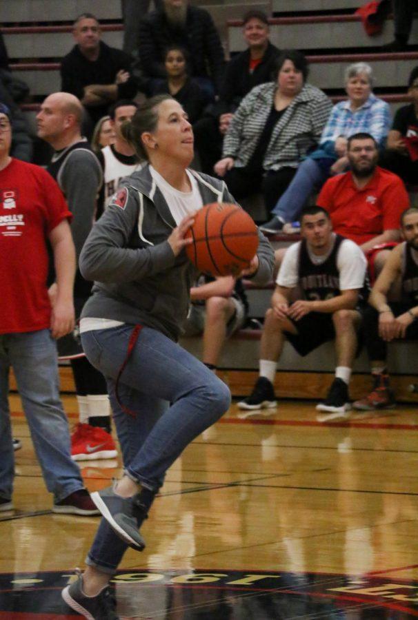 Teacher Michole Mattix forms herself during a Half-Court Shot Contest.