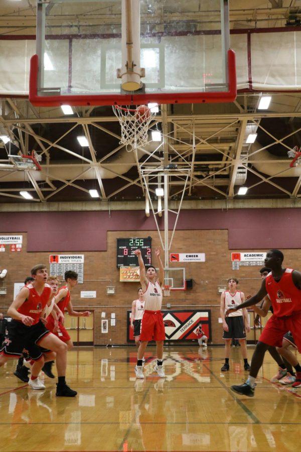 Junior Mason Christianson shoots a free throw shot.