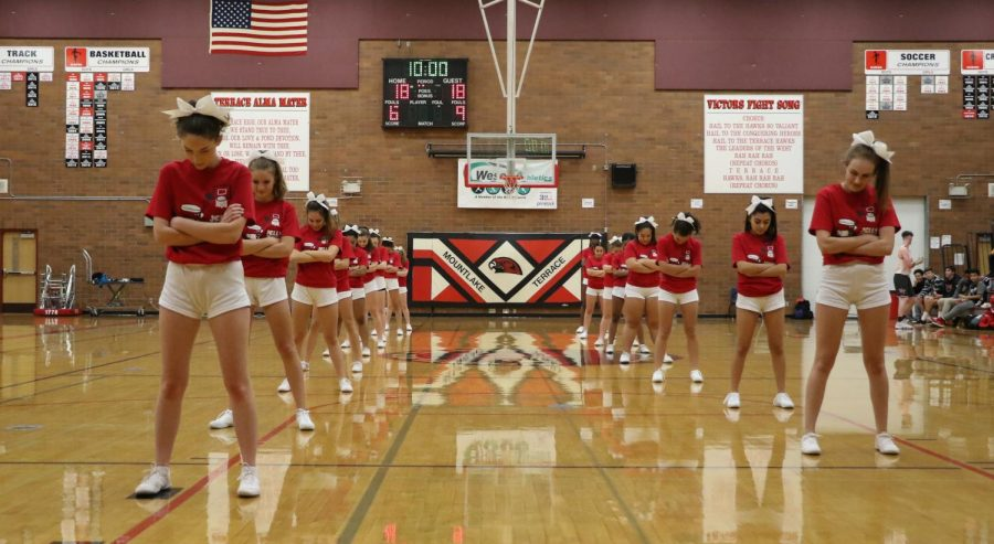 The cheer team performs a routine during half-time.