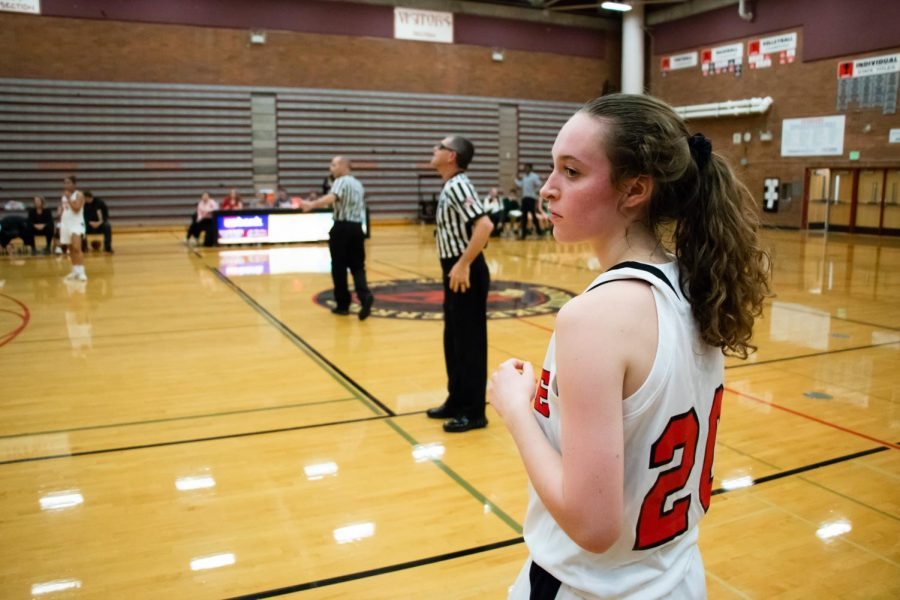 Sophomore guard Kaiya Beavin looks on as she prepares to inbound the basketball for the Hawks.