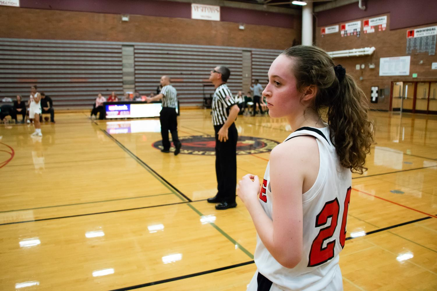 Sophomore+guard+Kaiya+Beavin+looks+on+as+she+prepares+to+inbound+the+basketball+for+the+Hawks.+