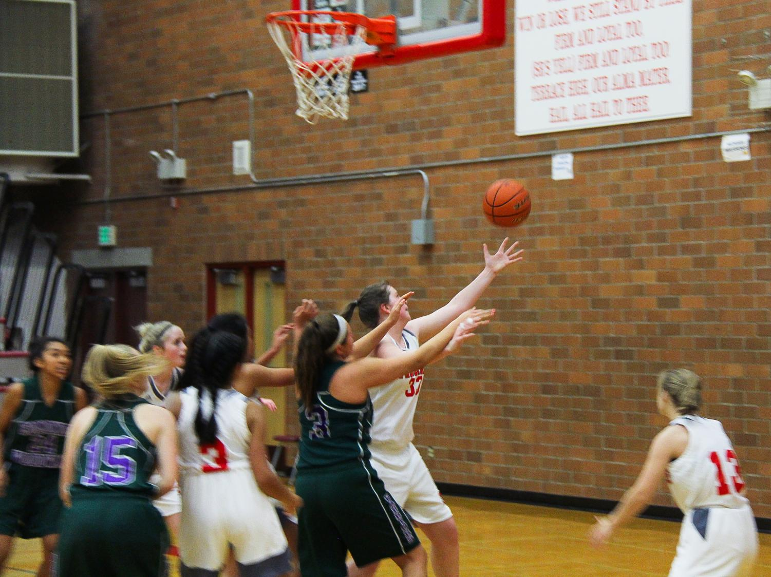 Freshmen+Isabelle+Allred+goes+for+a+rebound+in+the+paint+versus+a+Woodway+player