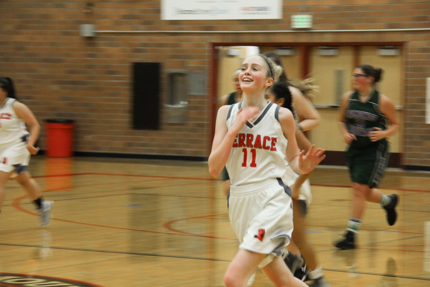 Freshman+wing+Taylor+Stevens+smiles+and+runs+back+on+defense+after+making+a+layup+basket+for+2+points.