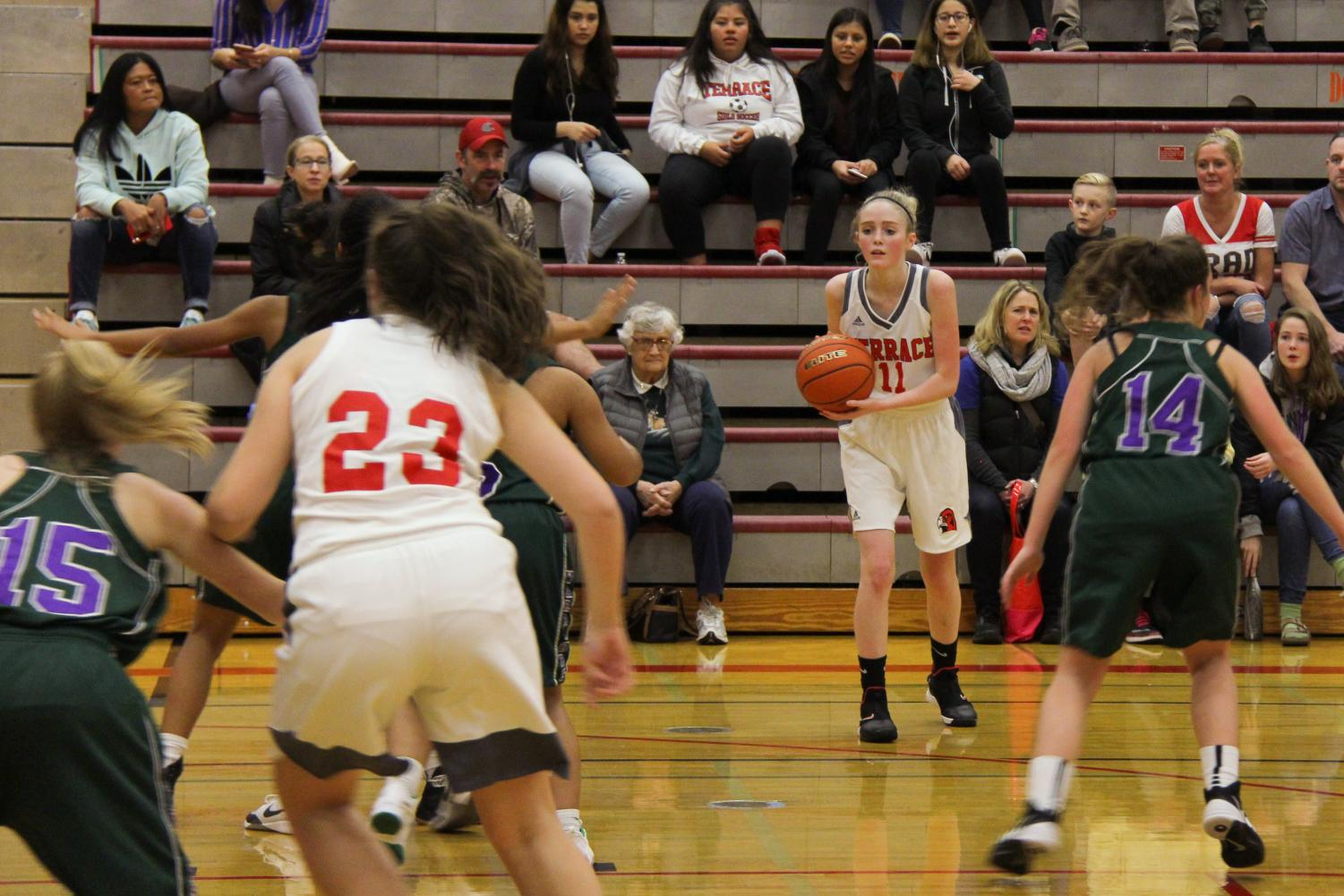 Freshman+wing+Taylor+Stevens+prepares+to+shoot+a+3+point+jump+shot+in+the+2nd+quarter+of+the+Terrace+vs+Woodway+basketball+game.