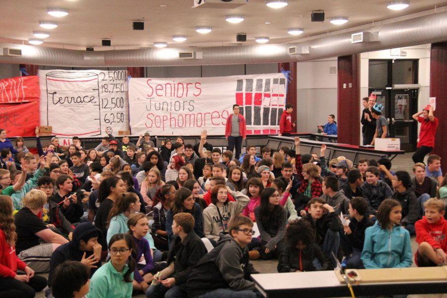 Eighth graders listen to a presentation by STEM teacher Bryan Smelcer.