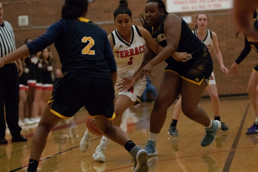 Junior Kierra Scott	pushing her way up to the hoop.