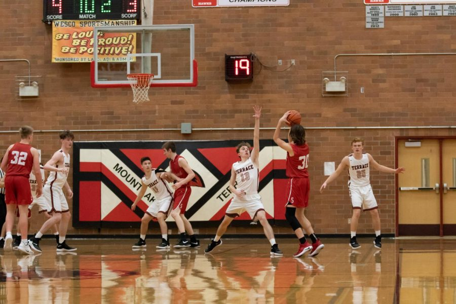 Senior Guard Trevor Lean extends to block a shot by Snohomish's Tayte Conover.