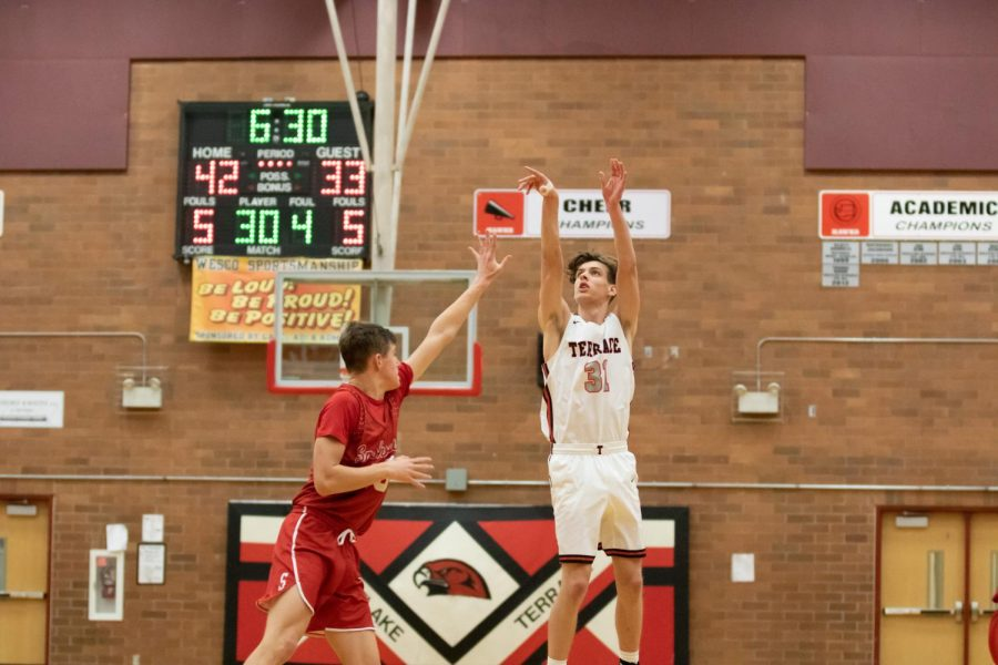 Senior Guard Mason Petersen takes a deep three in the 4th quarter. One of the Five made threes in the game.