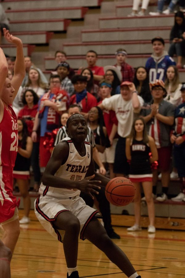 Anyima looks up to shoot the ball.