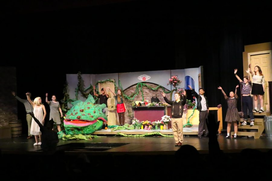 All of the cast waves goodbye to the crowd as the curtains set on the last scene.