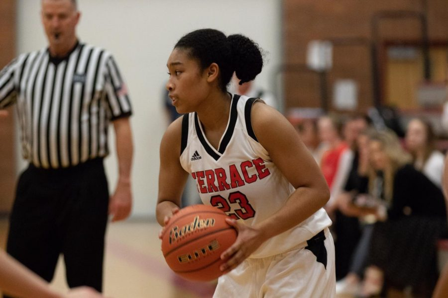 Lydia Prelow, a senior, looks around for an open player to pass to.