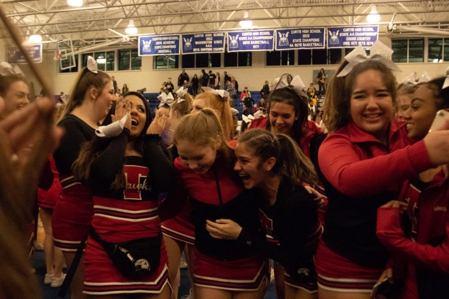 The MTHS Cheerleading team embraces one another after finding out they qualified for the WIAA State Cheerleading Championships.