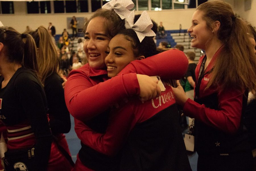 Sophomores Jurnee Saltzgiver and Meron Kassa hug each other after finding out they will make it to state championships.