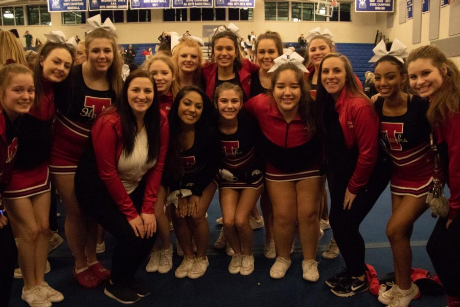 The Cheer team, led by Coach Jessica Ellersick, poses.
