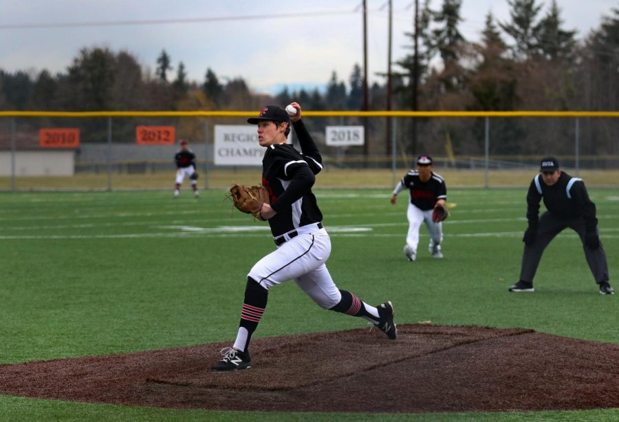 Dillon Gordon pitches the ball in the game against Arlington.