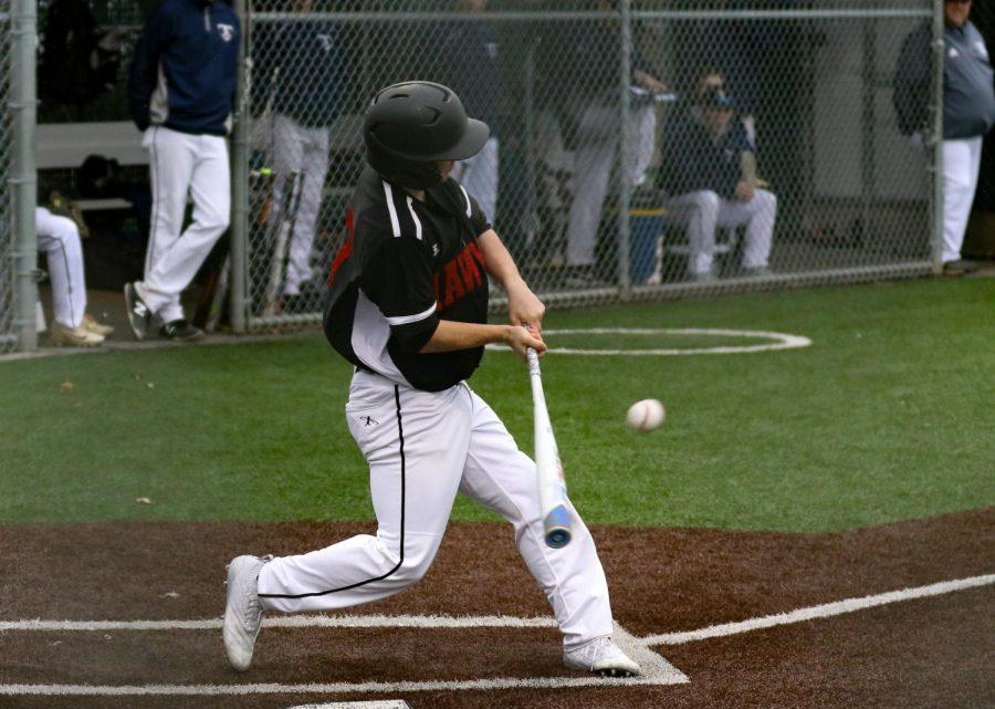 Layne Zuschin swings his bat in the game against Arlington.