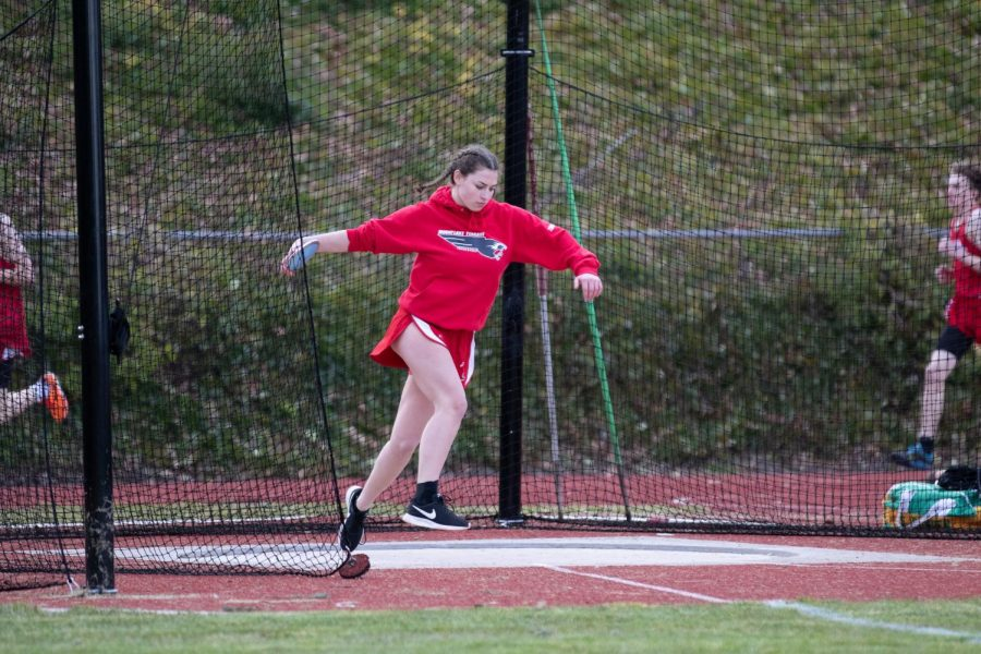 Senior Grace Davidson prepares to throw the discus.