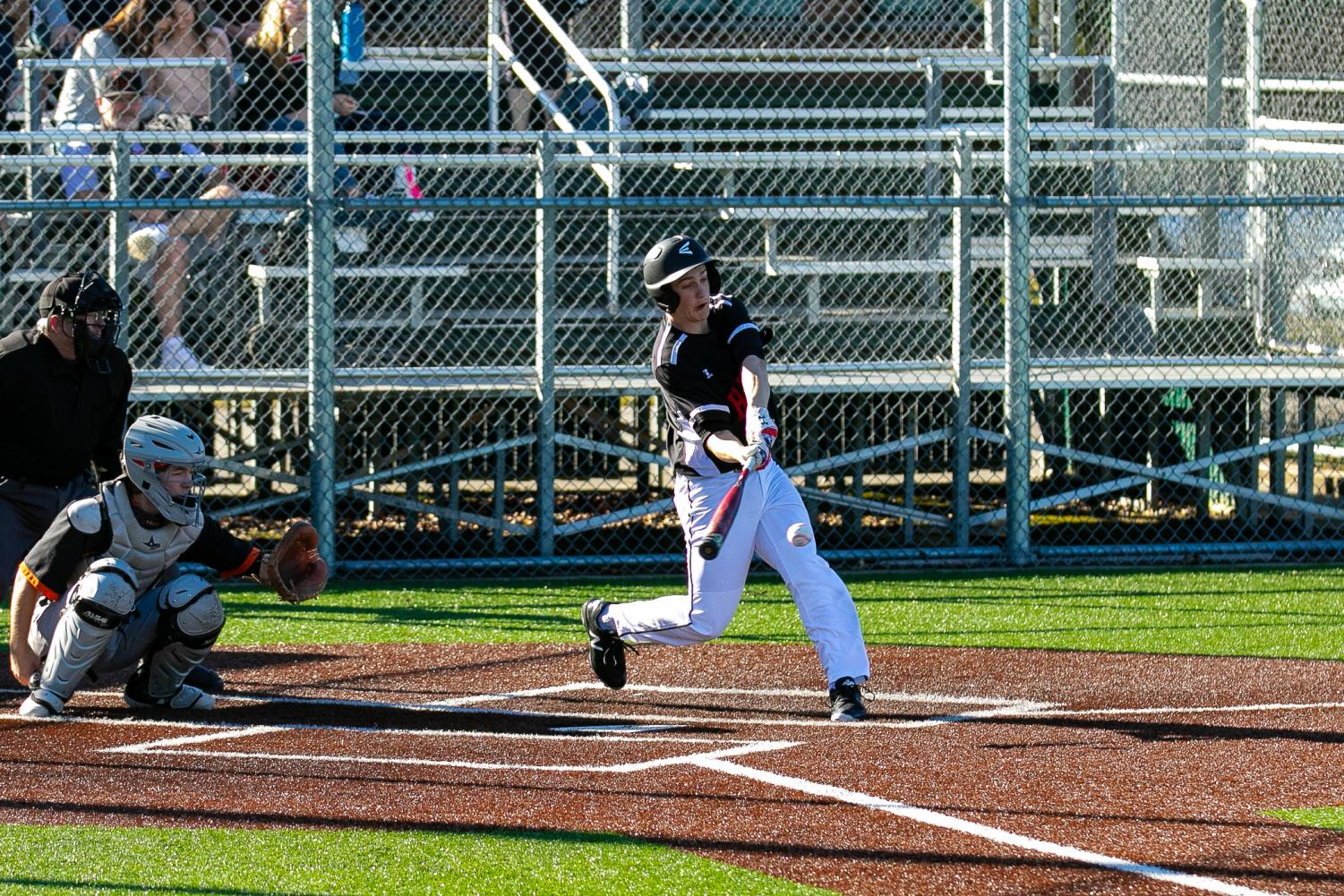 Caden Alley swings his bat at the ball