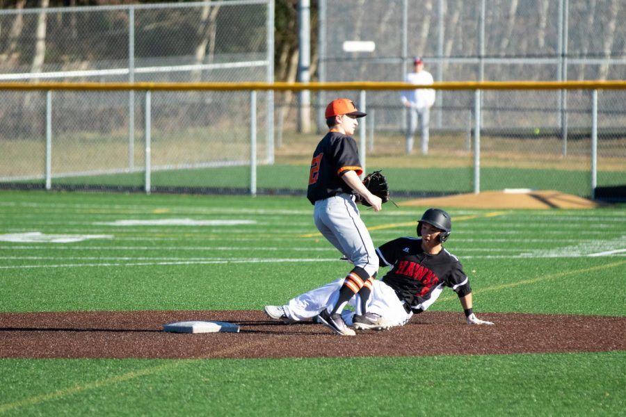 Senior Jonathan Kumai slides onto second base