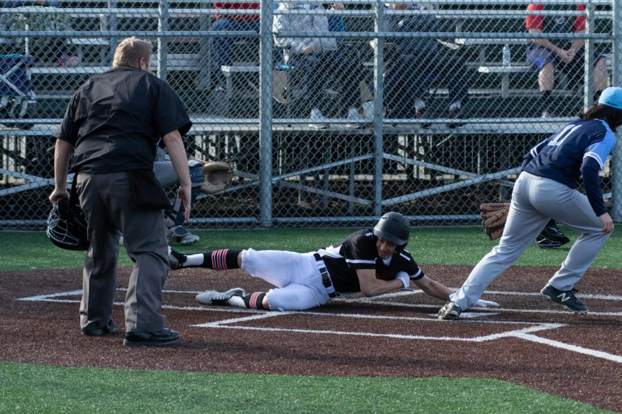 Sophomore Ryan Cacatian slides home in the game vs Interlake