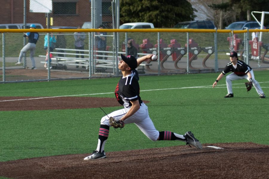 Sophomore Ryan Cacatian pitches vs Interlake