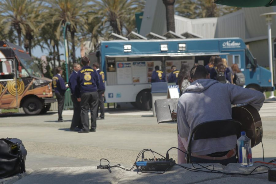 FFA members gather outside  around the food trucks that surround the Anaheim Convention Center in the afternoon.