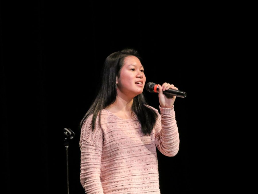 With a smile, freshman Anabelle Sumera-Decoret sings