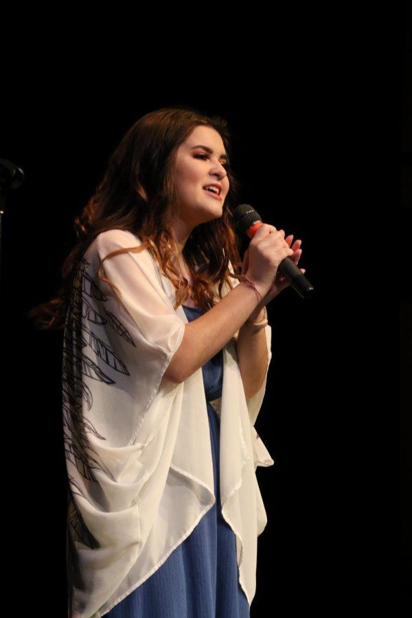 Junior Rhiannon Aguilar sings