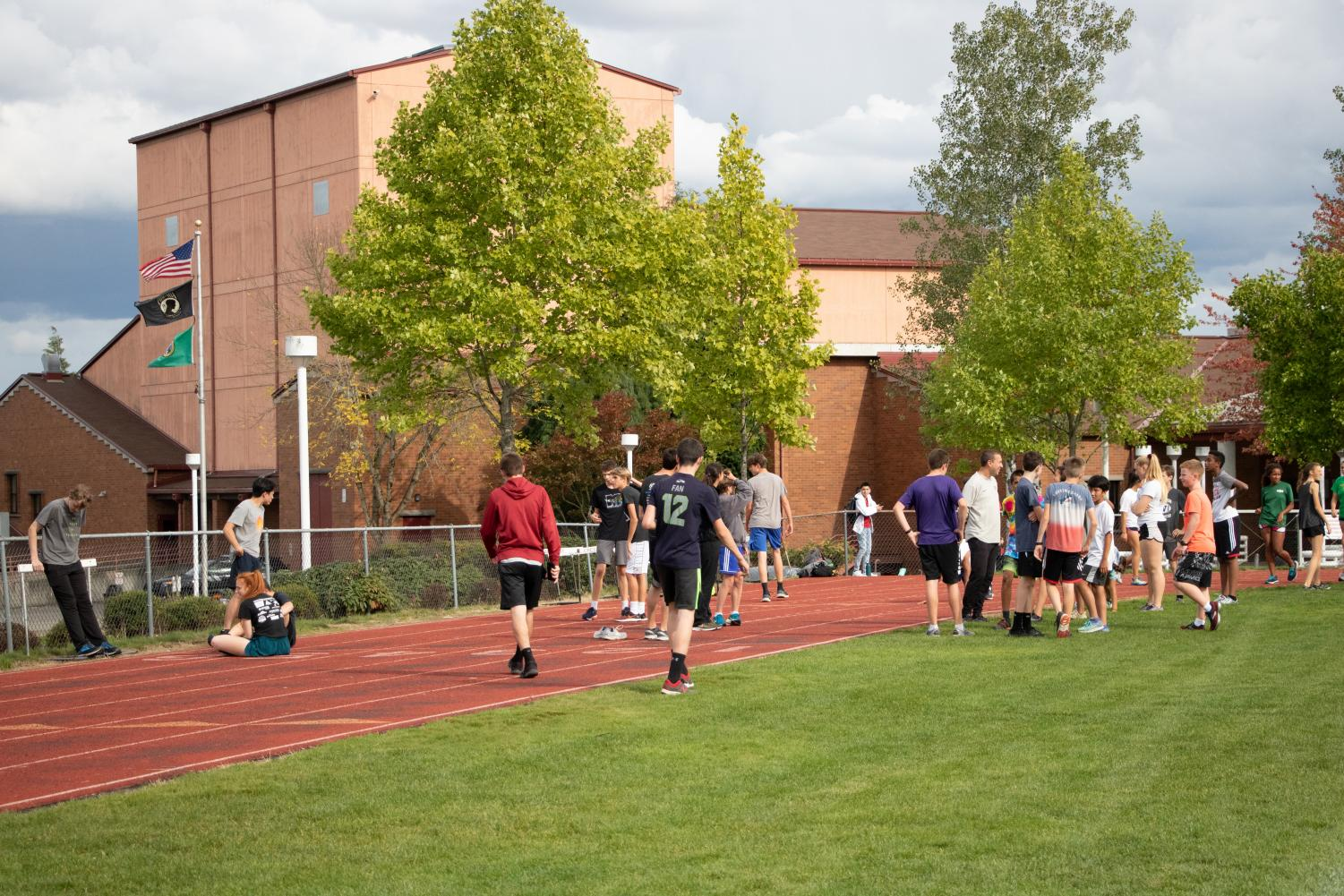 The cross country team takes a rest from their run during practice on the MTHS track. The team's enrollment has skyrocketed this school year, as 66 students are now participating as full members of the team for the fall season.