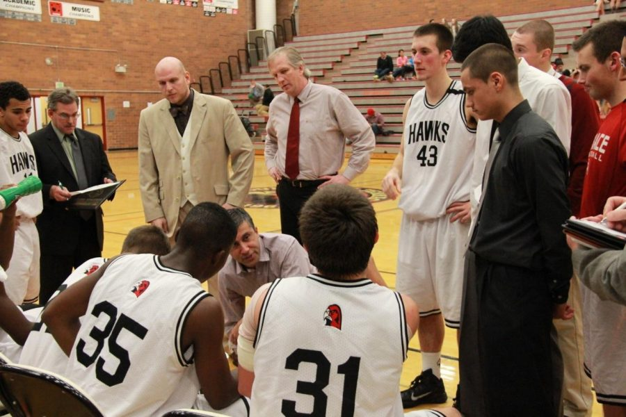 Coach Sood talks to the Hawks men's basketball team during a time-out in the Terraceum during the 2015 season.