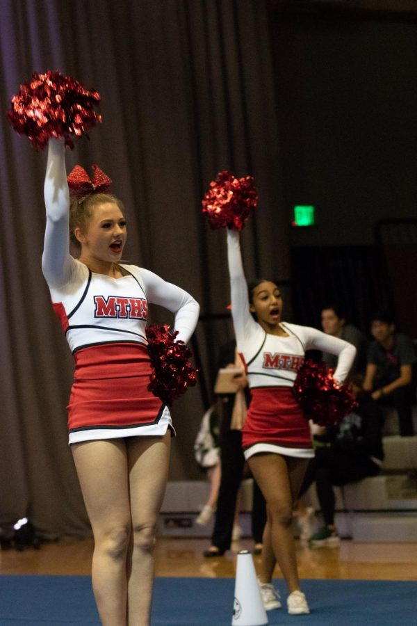 Milly Hansen (left) and Meron Kassa (right) perform a right hand up during their routine.