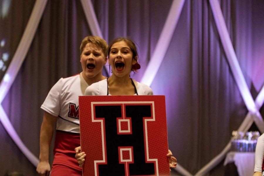 Senior Liliana Garza shouts with freshman Ryan Daly behind her.